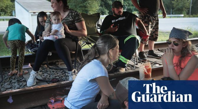 Laid off and owed pay: the Kentucky miners blocking coal trains